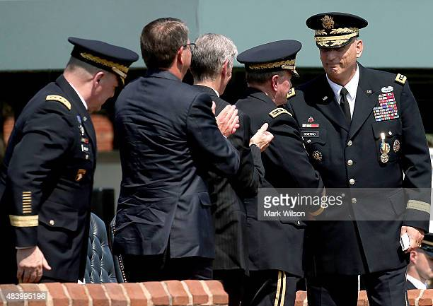 Army Chief of Staff Gen Ray Odierno is congratulated by Chairman of the Joint Chiefs of Staff Army Gen Martin Dempsey Army Secretary John McHugh US...