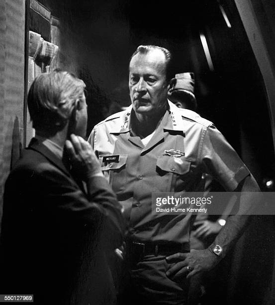 US Army Chief of Staff General Frederick Weyand talks to US Ambassador Graham Martin shortly before landing in Saigon aboard a US Air Force C5A...