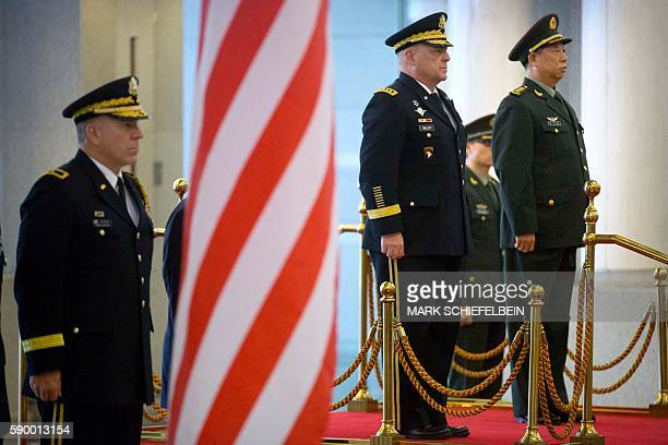 US Army Chief of Staff General Mark Milley and China's People's Liberation Army General Li Zuocheng stand to attention during a welcome ceremony at...