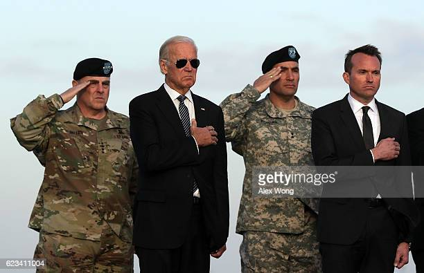 Army Chief of Staff General Mark Milley Vice President Joseph Biden Major General Andrew P Poppas and Army Secretary Eric Fanning attend a dignified...