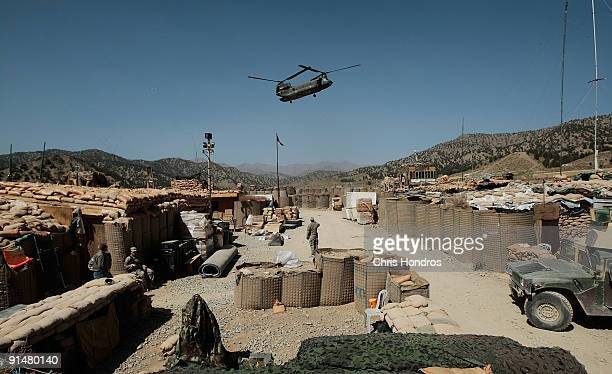 Army Chinook helicopter flies October 6 2009 over Forward Operating Base Zerok in Paktika province Afghanistan Conditions are harsh for the soldiers...