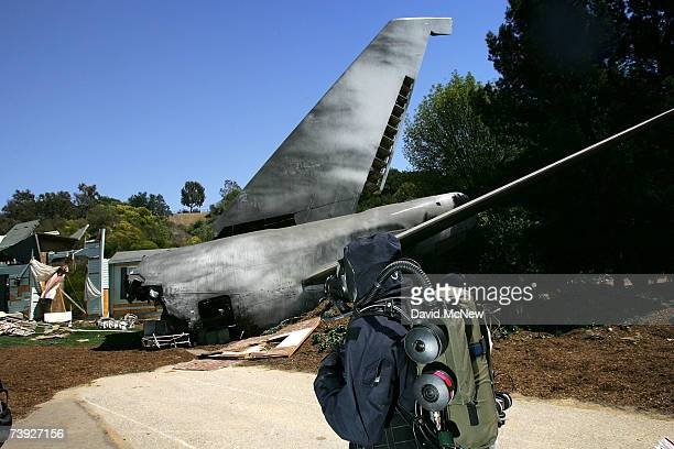 Army Civil Support Team member searches for hazards during an exercise simulating mass casualties from the collision between a singleengine Cessna...