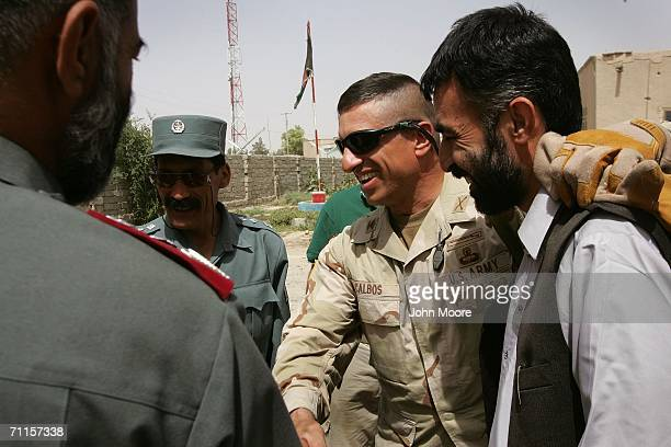 S Army Col Paul Calbos celebrates with Afghan police officials after hearing the news of the death of insurgent leader Abu Musab AlZarqawi June 8...