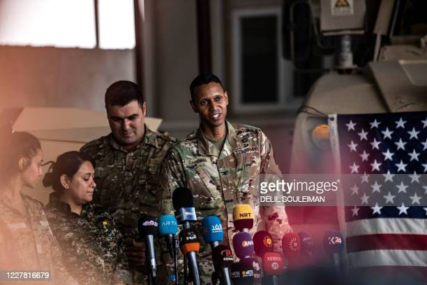 Army Colonel Myles Caggins, official military spokesperson for international military intervention against the Islamic State , speaks at a military...
