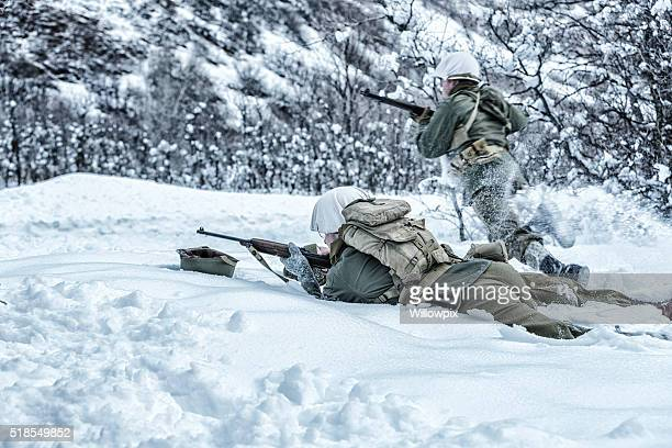 WWII US Army Combat Soldiers Advancing To Return Enemy Fire
