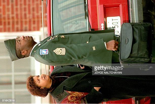 Army Command Sgt Major Gene C McKinney arrives at the courthouse with his wife Wilhelmina 03 February at Fort Belvoir VA If found guilty of sexual...