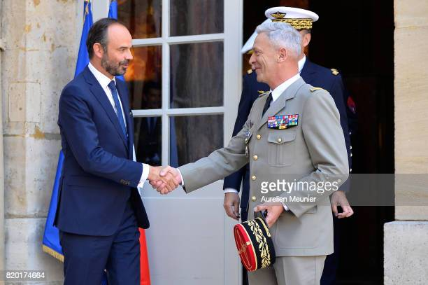 Army Commander in Chief General Francois Lecointre and French Prime Minister Edouard Philippe shake hand after a meeting at Hotel Matignon on July 21...