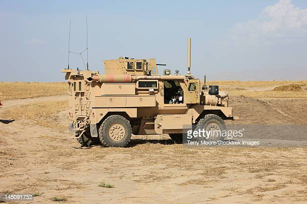 a u.s. army cougar mrap vehicle. - mine resistant ambush protected stock pictures, royalty-free photos & images