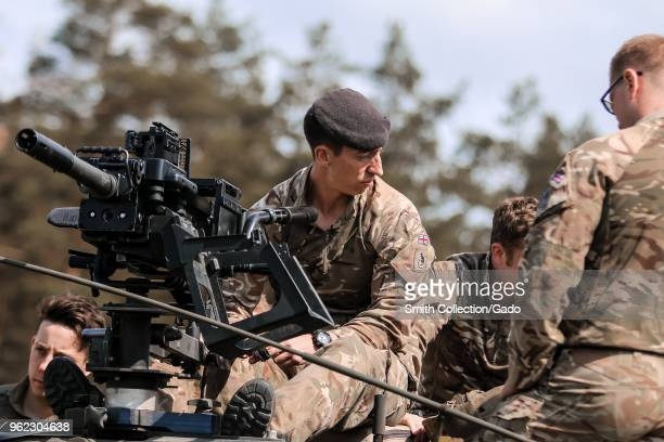 UK army crew commander Cpl Nicolas Steri teaching soldiers from the 1st The Queen's Dragoon Guards to use an L134A1 Grenade Machine Gun at Bemowo...