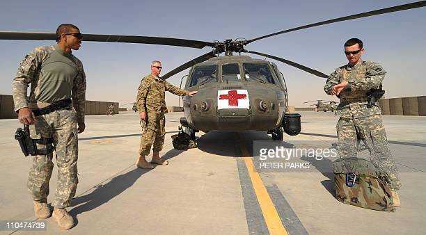 A US army crew from Company C 1st Battalion 52nd Aviation Regiment MEDEVAC unit prepare their Blackhawk helicopter at Kandahar airfield in southern...