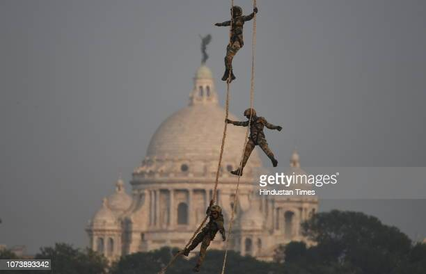 Army displays aerial show during Military Tattoo show at Royal Calcutta Turf Club on December 14 2018 in Kolkata India A two day show to commemorate...