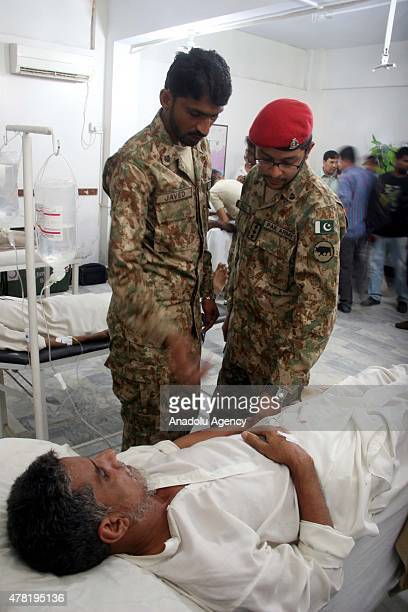 Army doctors examine a patient who was affected by the heatwave at heat strokes centre in Karachi on June 23 2015 The death toll from a threeday long...