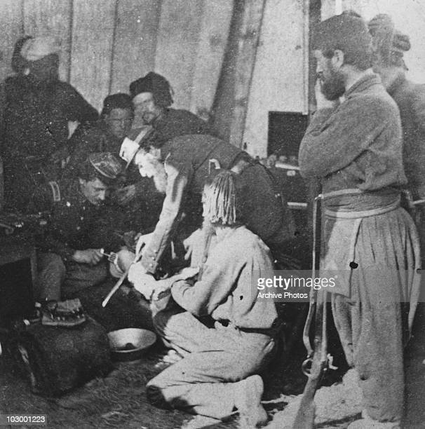 Army doctors performing an amputation in a makeshift hospital during the American Civil War USA circa 1863