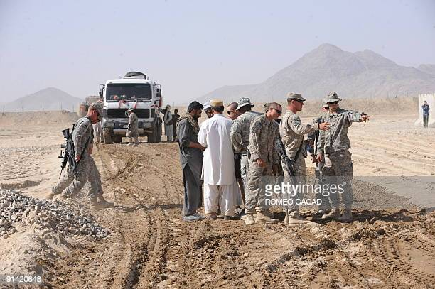 US Army engineers and Aghan workers build a road inside the forward operating base of the US Army 5th Stryker Brigade Combat Team 2nd Infantry...