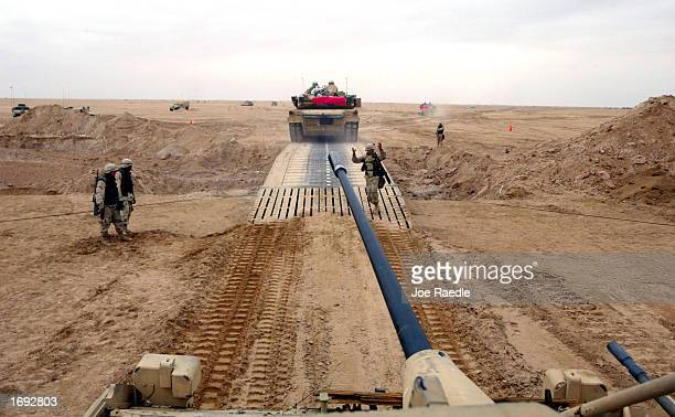 S Army Engineers guide a M2A2 Bradley Fighting Vehicle across a bridge December 18 2002 near the Iraqi border in Kuwait They are part of the Armored...