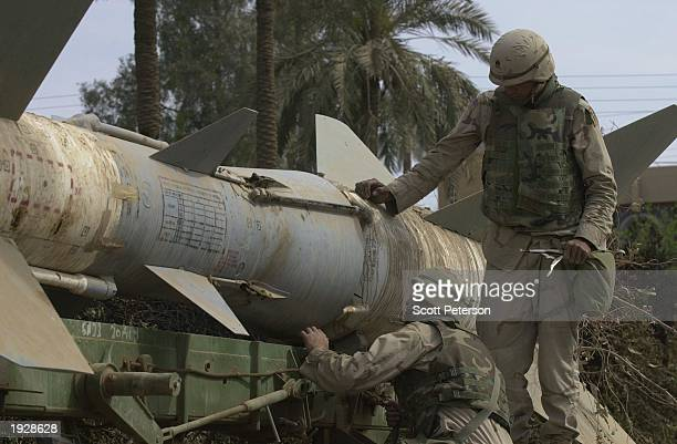 S Army explosives experts dismantle an Iraqi surfacetoair SA2 missile left on the street April 12 2003 in Baghdad Iraq US forces are now beginning...