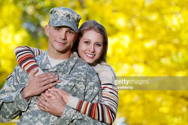 army family series: real american soldier & wife - military spouse stock pictures, royalty-free photos & images