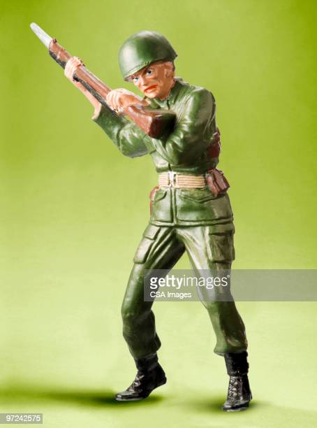 army fighter - army soldier toy stock pictures, royalty-free photos & images