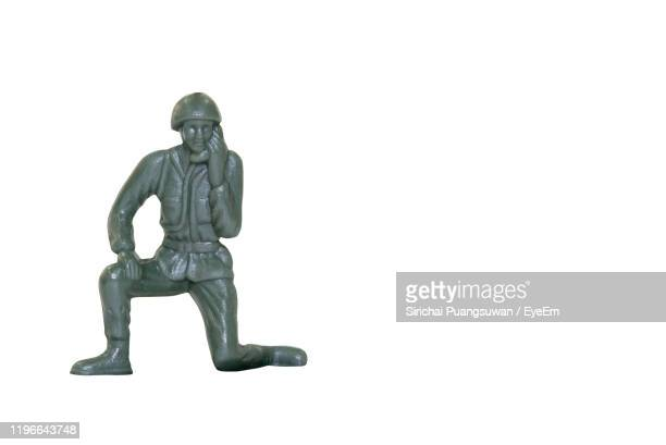 army figurine against white background - army soldier toy stock pictures, royalty-free photos & images