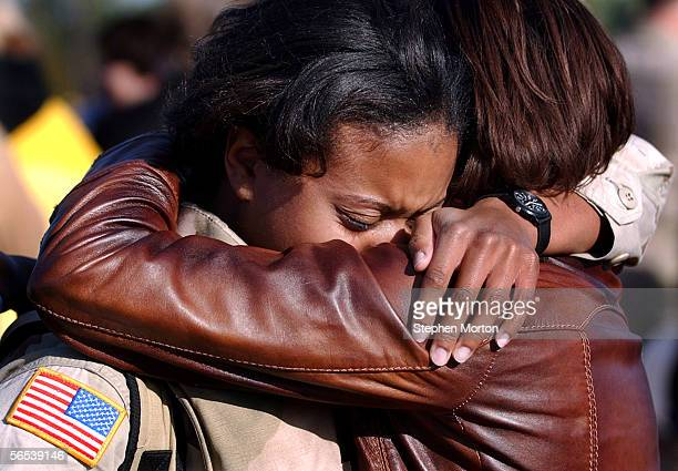 Army First Lt. Alisha Vanghn is greeted by her friend First Lt. Shandale Hall during a welcome home ceremony for 330 soldiers from the 3rd Infantry...