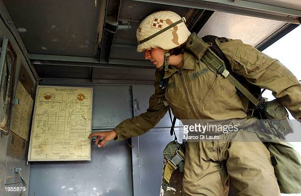 S Army First Lt Valerie Phipps of Sherwood Arkansas points out chemical charts inside a mobile laboratory April 28 2003 in the outskirts of Baiji in...