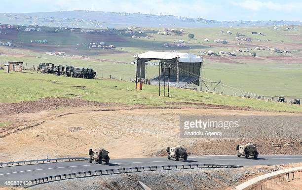 Army Force stands guard during late South African president Nelson Mandela's funeral ceremony helds in his ancestral home in Qunu village in the...