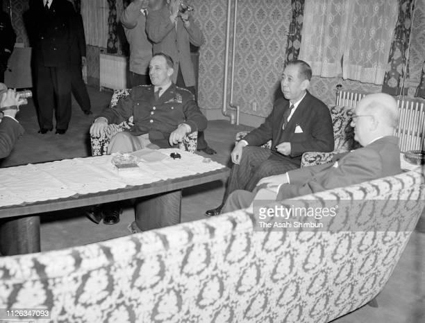 US Army forces in the Far East Commander Lyman Lemnitzer Japanese Foreign Minister Nobusuke Kishi and US Ambassador to Japan John Moore Allison hold...