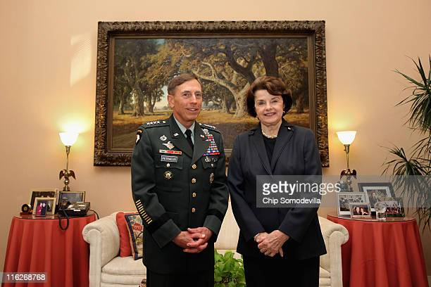 S Army Gen David Petraeus commander of US and ISAF forces in Afghanistan poses for photographs with Senate Select Committee on Intelligence Chairman...