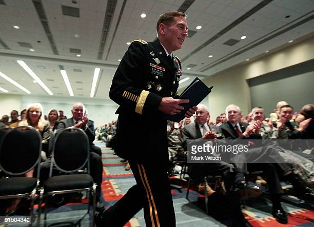 S Army Gen David Petraeus walks onstage to speak at the Convention and Exposition of the Association of the United States Army at the Convention...