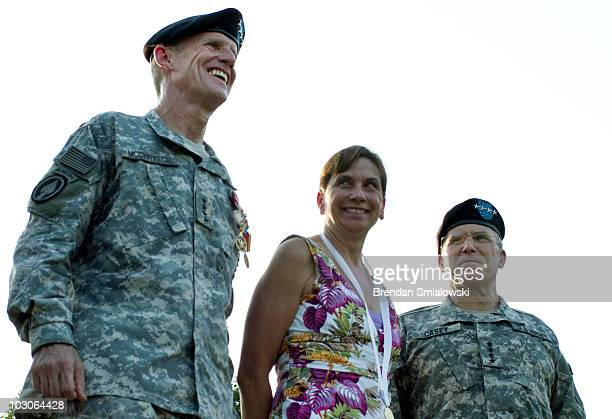 Army Gen Stanley McChrystal his wife Annie McChrystal and Army Chief of Staff Gen George W Casey Jr watch troops parade during a retirement ceremony...