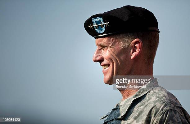 Army Gen Stanley McChrystal smiles after receiving the Department of Defense Distinguished Service Medal and the Army Distinguished Service Medal...