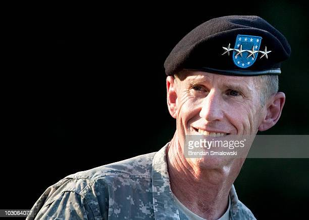 Army Gen Stanley McChrystal smiles while speaking during his retirement ceremony at Fort McNair July 23 2010 in Washington DC The ceremony honored...