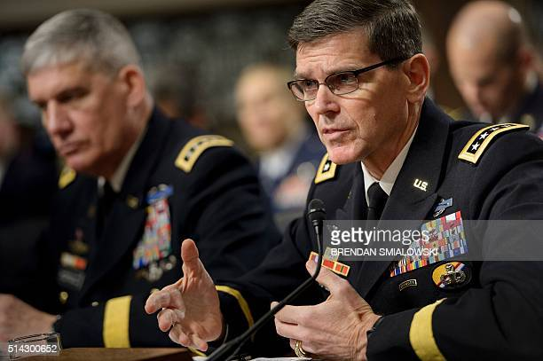 Army General David Rodriguez commander of the US Africa Command listens while Army General Joseph Votel commander of the US Special Operations...