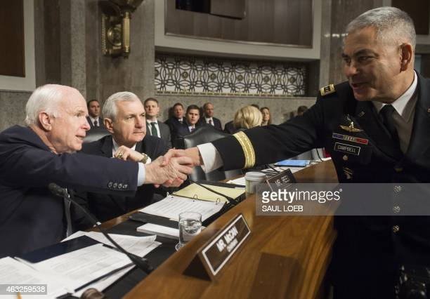 US Army General John Campbell commander of the International Security Assistance Force US Forces Afghanistan shakes hands with US Senator John McCain...