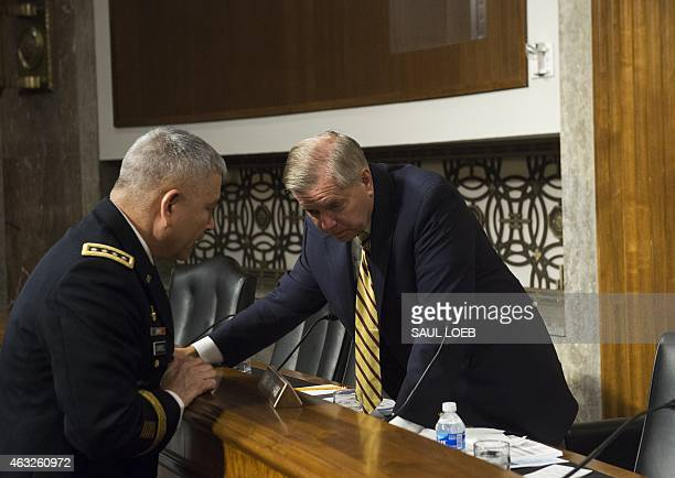 US Army General John Campbell commander of the International Security Assistance Force US Forces Afghanistan speaks with US Senator Lindsey Graham...