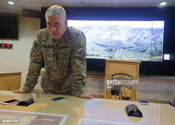 US Army General John Campbell the commander of international and US forces in Afghanistan listens to journalists during a news conference at Resolute...