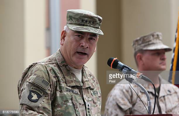 US Army General John Campbell the outgoing commander of Resolute Support forces and United States forces in Afghanistan speaks during a change of...