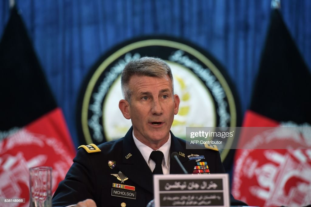 US Army General John Nicholson, commander of US forces in Afghanistan, takes part in a press conference in Kabul on August 24, 2017. Afghanistan has welcomed President Donald Trump's move to commit thousands more troops to America's longest war, reversing earlier pledges to pull out, but Taliban insurgents vowed to make the country a 'graveyard' for US forces. MARAI