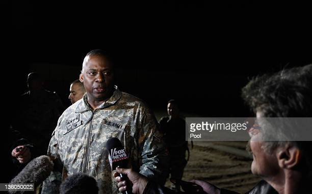 Army General Lloyd Austin, Commander of U.S. Forces in Iraq, speaks with Geraldo following a casing of the colors ceremony at Camp Adder on December...