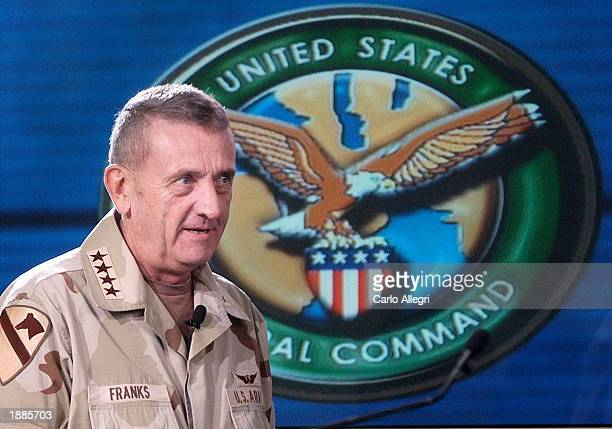 US Army General Tommy Franks walks into the briefing area of Coalition Media Center to speak with reporters March 30 2003 in Camp As Sayliyah Doha...
