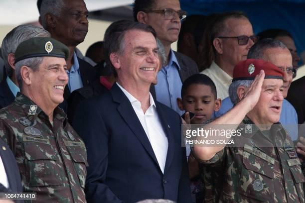 Army General Walter Souza Braga Netto Brazil's Presidentelect Jair Bolsonaro and Minister of the Brazilian Military Superior Court General Luis...