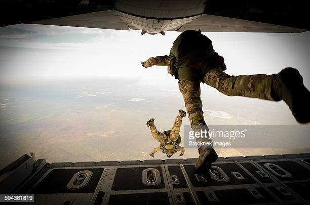 U.S. Army Green Berets jump out of a C-130H3 Hercules over Florida.