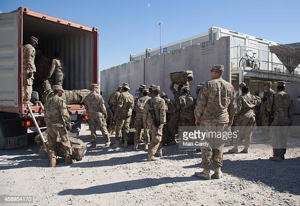 Army guardsmen load a lorry with their luggage as they leave at the end of their tour at Kandahar airfield on November 14 2014 in Kandahar...