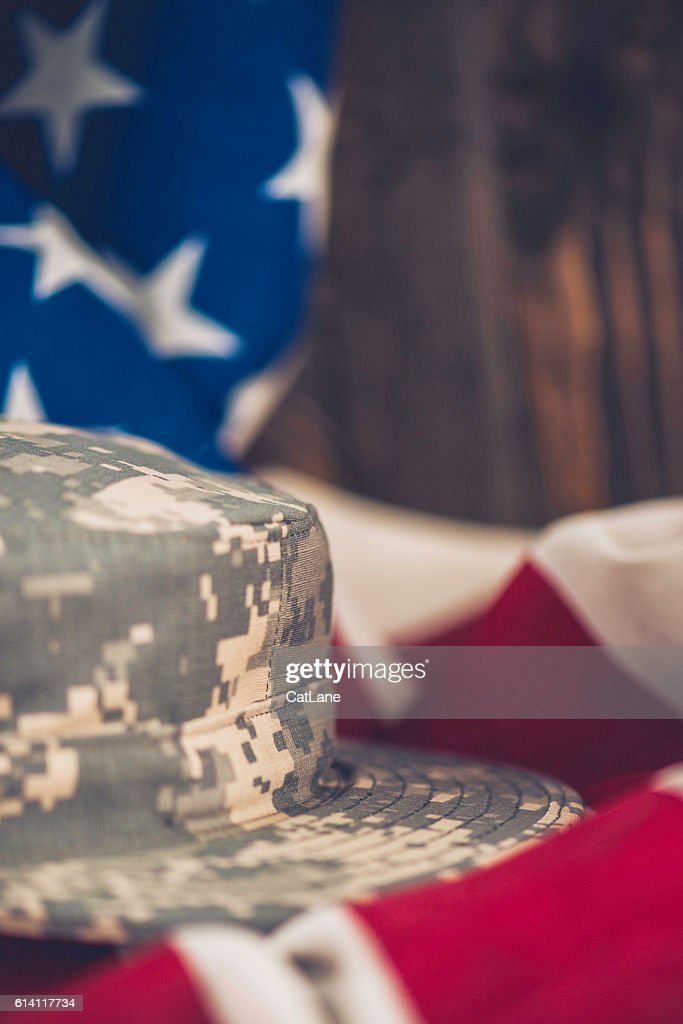 Us Army Hat On American Flag With Rustic Wood Background Stock Photo ... 81034dc0c52