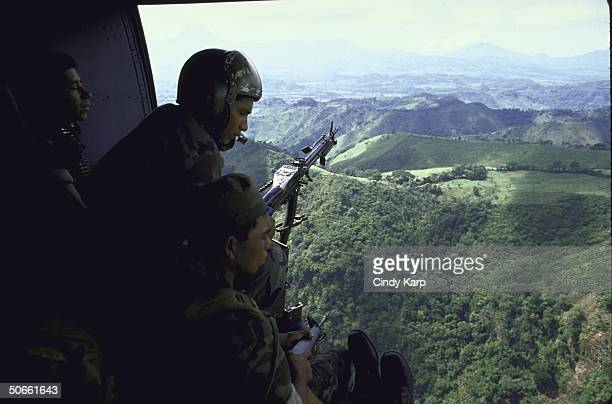 Army helicopter being used to evacuate sick civilian woman
