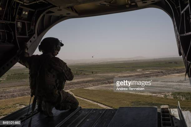 S Army helicopter flies from Camp Shorab to Camp Bost on September 11 2017 in Helmand Province Afghanistan About 300 marines are currently deployed...