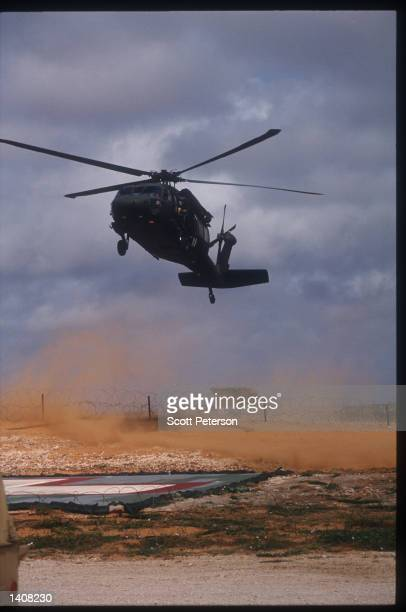 Army helicopter flies October 13 1993 over Mogadishu Somalia Two US Army Airborne Ranger''s helicopters were shot down October 3 1993 during a...