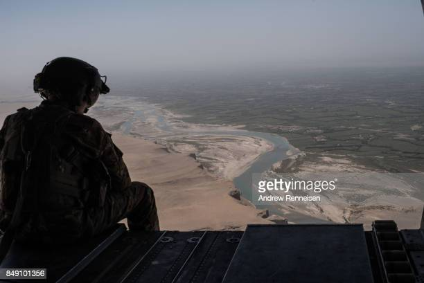 S Army helicopter flies outside of Camp Shorab on a flight to Camp Post on September 11 2017 at Camp Shorab in Helmand Province Afghanistan About 300...