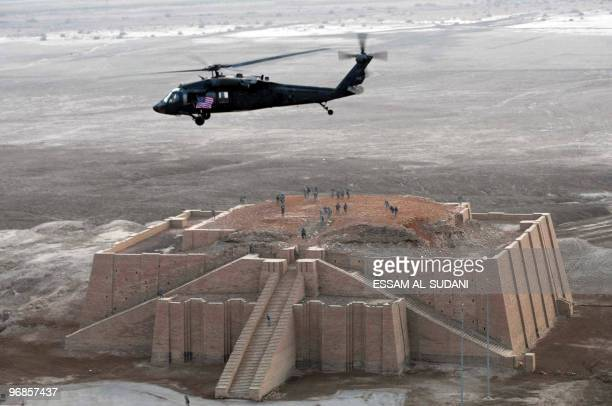 US army helicopter flies over the stepped Ziggurat temple a threetiered edifice dating back to 2113 BC in the ancient city of Ur in southern Iraq on...
