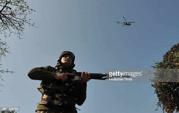 A army helicopter hovering over the sky during a search operation outside the camp of the General Engineering Reserve Force the site of a militant...